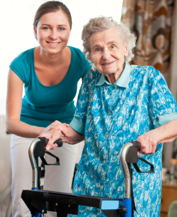caregiver assists the elderly woman