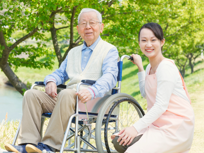 young caregiver and an elderly man