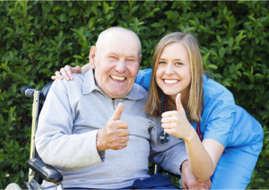 patient showing thumbs up together with his caregiver